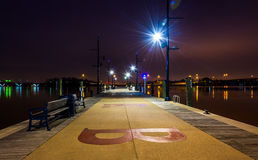 A pier at night, in National Harbor, Maryland. Royalty Free Stock Image