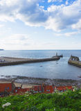Pier in North Sea in Whitby in North Yorkshire in England Royalty Free Stock Images