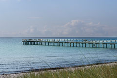 Pier and ocean. Pier going out in the water Stock Image