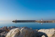Pier and ocean horizon Stock Images