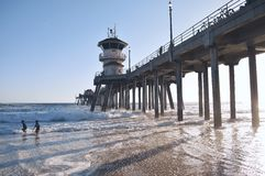 Pier by ocean shore with watchtower Stock Images