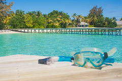 Pier by the ocean. Tropical paradise for diving. Pier by the ocean and snorkel mask on wooden. Tropical paradise for diving. Focus of pier Stock Photos