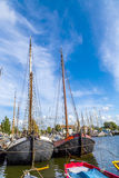 Pier with old boats in Harlingen. Netherlands Royalty Free Stock Photography