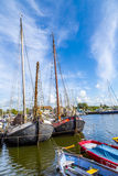 Pier with old boats in Harlingen Stock Photos