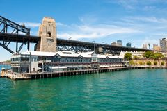 Pier One, Autograph Collection Hotel, and Sydney Harbour Bridge royalty free stock photo