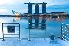 The pier opposite Marina Bay Sands Hotel, Singapore. Singapore, Singapore - July 17, 2013: The pier opposite Marina Bay Sands Hotel in the early morning, July 17 royalty free stock photo
