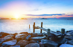 Pier over sunset waters Royalty Free Stock Images