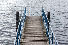 Pier over the waters of the lake Royalty Free Stock Images