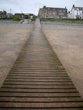 Pier over zandig strand royalty-vrije stock afbeelding