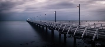 Pier with overcast sky. Pier with grey overcast sky stock image