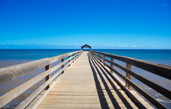 Pier in Pacific Ocean in Hawaii Royalty Free Stock Image