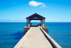 Pier in Pacific Ocean in Hawaii Royalty Free Stock Images