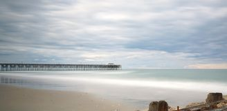 Pier at Pawleys Island. Pawleys Island Pier in South Carolina at sunset on a cloudy day Stock Image