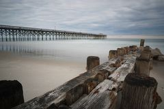 Pier at Pawleys Island. Pawleys Island Pier in South Carolina at sunset on a cloudy day Royalty Free Stock Photography