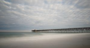 Pier at Pawleys Island. Pawleys Island Pier in South Carolina at sunset on a cloudy day Royalty Free Stock Images