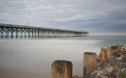 Pier at Pawleys Island. Pawleys Island Pier in South Carolina at sunset on a cloudy day Stock Images