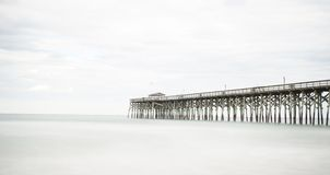 Pier at Pawleys Island. Pawleys Island Pier in South Carolina at sunset on a cloudy day Royalty Free Stock Photos