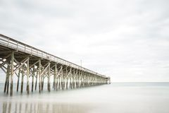 Pier at Pawleys Island. Pawleys Island Pier in South Carolina at sunset on a cloudy day Royalty Free Stock Image