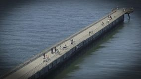 Pier 14 a pedestrian walkway that stretches out into San Francisco Bay stock video footage
