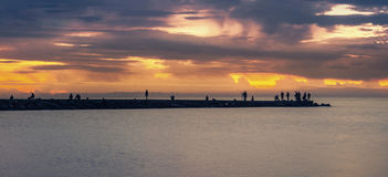 Pier. People on pier at sunset Royalty Free Stock Photos