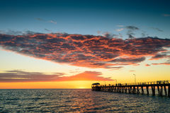 Pier with people at sunset Royalty Free Stock Image
