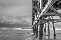 Pier Perspective. Tropical storm looms off the coast of Cherry Grove, SC. Cherry Grove Pier Stock Photos
