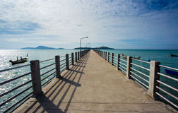 Pier on Phuket, the sea, the sky, boats Stock Images
