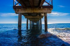 Pier. Wooden pier in Marbella. Malaga province, Costa del Sol, Andalusia, Spain Stock Images