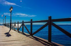 Pier. Wooden pier in Marbella. Malaga province, Costa del Sol, Andalusia, Spain Royalty Free Stock Photo