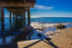 Pier. Wooden pier in Marbella. Malaga province, Costa del Sol, Andalusia, Spain Royalty Free Stock Photos