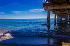 Pier. Wooden pier in Marbella. Malaga province, Costa del Sol, Andalusia, Spain Royalty Free Stock Photography