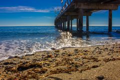 Pier. Wooden pier in Marbella. Malaga province, Costa del Sol, Andalusia, Spain Royalty Free Stock Image