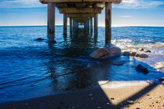 Pier. Wooden pier in Marbella. Malaga province, Costa del Sol, Andalusia, Spain. Picture taken – 14 december 2017 Stock Image