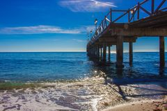 Pier. Wooden pier in Marbella. Malaga province, Costa del Sol, Andalusia, Spain. Picture taken – 14 december 2017 Stock Photos