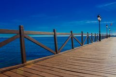 Pier. Wooden pier in Marbella. Malaga province, Costa del Sol, Andalusia, Spain. Picture taken – 14 december 2017 Royalty Free Stock Images