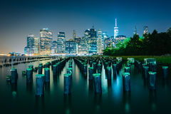 Pier pilings and the Manhattan skyline at night, seen from Brook Royalty Free Stock Image