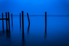 Pier pilings seen during twilight in the Chesapeake Bay, Havre d Royalty Free Stock Photos