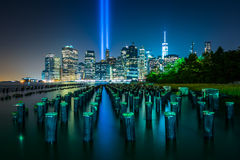 Pier pilings and the Tribute in Light over the Manhattan skyline Royalty Free Stock Photo