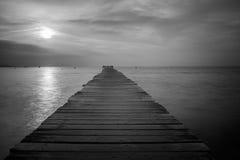 Pier at Playa del Muro in Alcudia, Spain. Black and white photo from the per at Playa del Muro in Alcudia, Spain Stock Photos
