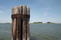 Pier Poles que negligencia o mar foto de stock royalty free
