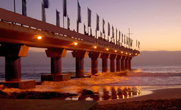 Pier in Port Elizabeth at sunrise. People on the famous pier of Hobie Beach, Port Elizabeth, Nelson Mandela Bay, Eastern Cape, South Africa, watching the sunrise royalty free stock photos