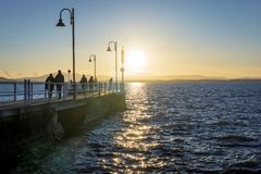 Pier and promenade at dusk Royalty Free Stock Images