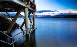 Pier of Puerto Rio Tranquilo. With the background of the mountains of the Andes mountain range and the General Carrera lake. Austral road. Region of Aysen stock images