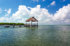 Pier in Punta Allen, Mexico. Rustic pier in the Sian Kaan Biosphere Reserve in Punta Allen, Mexico Royalty Free Stock Photography