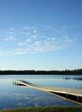 The pier and quiet lake. Quiet time near the lake next to bog Royalty Free Stock Photography