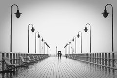 Pier in rain Stock Photo