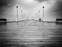 Pier in the rain. Artistic look in black and white. Stock Photography
