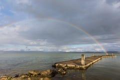 Pier and rainbow Stock Image