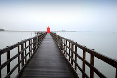 Pier with a red cab Patrol Royalty Free Stock Image
