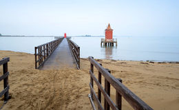 Pier with red tower.Lignano-Italy. Old lighthouse in Lignano Sabbiadoro, Italy Royalty Free Stock Images